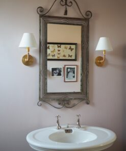 Wall sconce light in pink bathroom