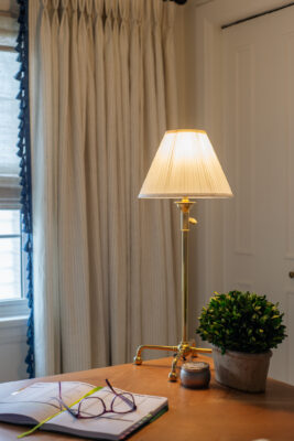 Table lamp with white lampshade and gold lamp base